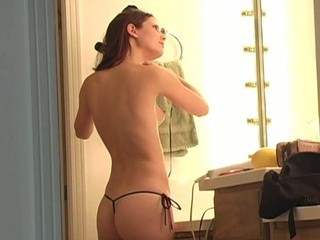 Longhaired sweetheart is inserting banana in her luscious love tunnel