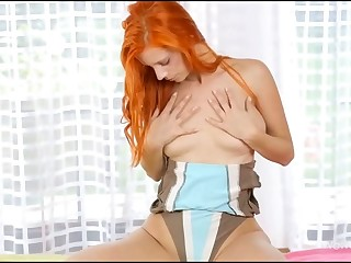 Fascinating cutie is becoming stripped and then caressing her moist muff