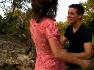 Concupiscent teen hottie bonks on a fallen treen outdoors with partner