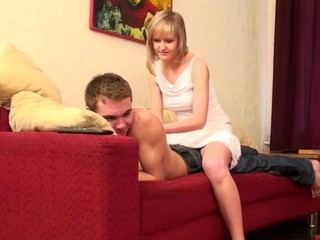 Bewitching babe enjoys sex on the red couch with her partner