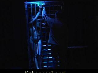 Restrained and tied in the metal cage cute young golden-haired Willa is Master's tractable thrall. Whenever that dude feels like playing kinky that dude takes her out and enjoys the view of having her spanked and drilled