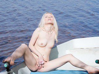 What can a marvelous golden-haired do all alone in a boat in the centre of a lake? Check out in this steamy art porn clip!