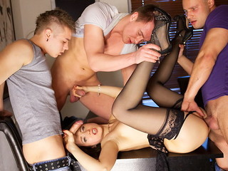 Sexually excited underware doll in darksome stockings Taissia receives discharged on hardcore porno clip when drilled by 3 guys